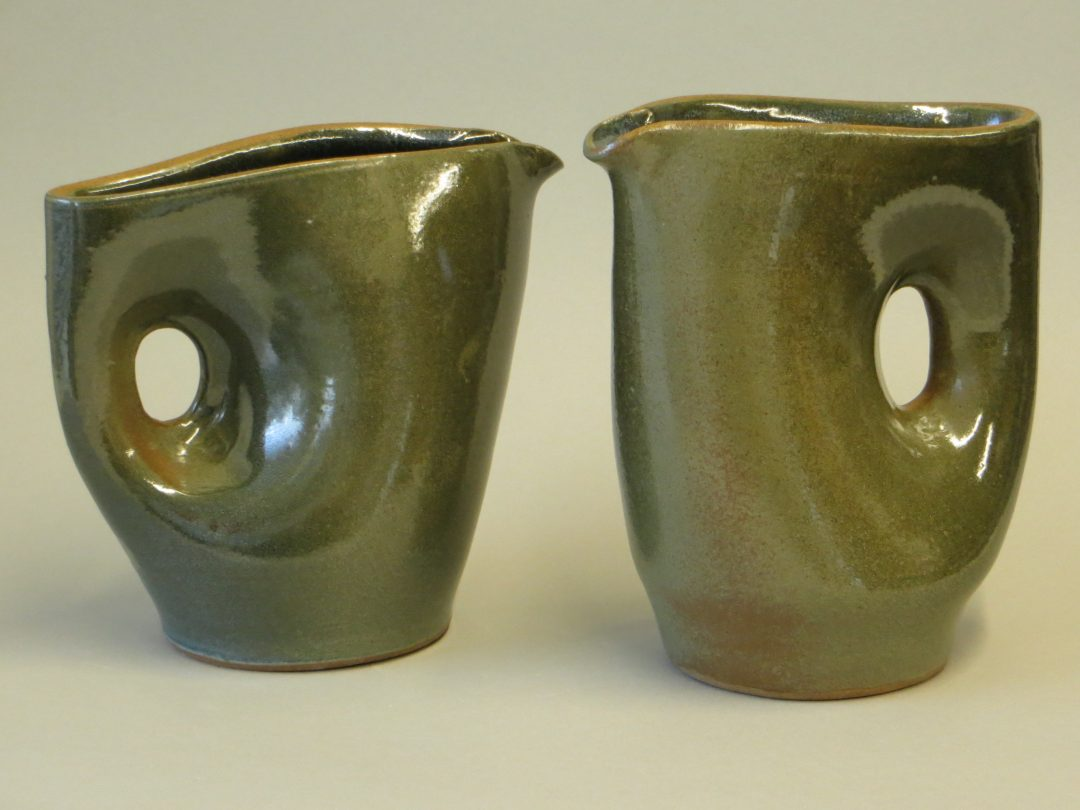 green magnatite pinched jugs